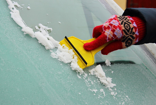 Scraping Ice Off Of Windshield